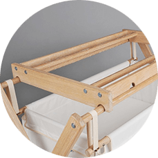 Cradle with wooden superstructure